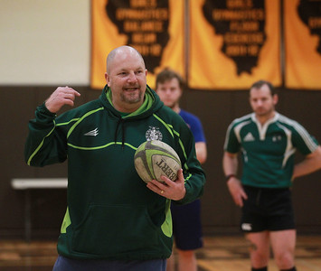 Candace H. Johnson-For Shaw Media Mike Bruce, of Grayslake, head coach, goes over a passing drill with his team during a Lake County Rugby Club's practice at Carmel Catholic High School in Mundelein. (2/27/20)