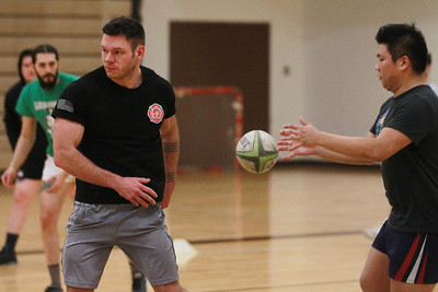 Candace H. Johnson-For Shaw Media Kyle Bittner, of Grayslake passes the ball to Kevin Cao, of Vernon Hills during a Lake County Rugby Club's practice at Carmel Catholic High School in Mundelein. The rugby club welcomes new players. The season begins on March 14th.    (2/27/20)