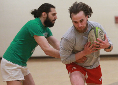 Candace H. Johnson-For Shaw Media Tyler Kuligowski, of Grayslake makes a pass to Jack Goss, of Lake Bluff during a Lake County Rugby Club's practice at Carmel Catholic High School in Mundelein. The rugby club welcomes new players. The season begins on March 14th.    (2/27/20)