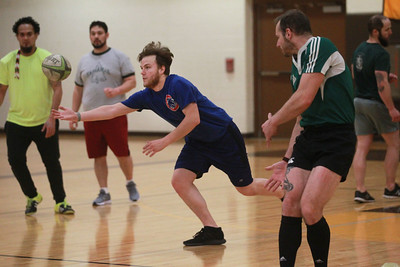 Candace H. Johnson-For Shaw Media Max Lynn, of Woodstock reaches for a pass for an active passing drill during a Lake County Rugby Club's practice at Carmel Catholic High School in Mundelein. The season begins on March 14th. (2/27/20)