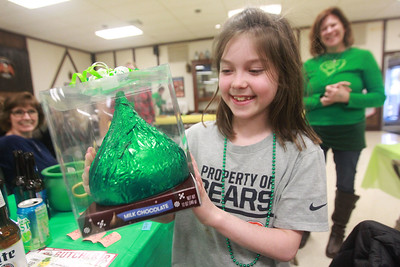 Candace H. Johnson-For Shaw Media  Kate Lindblom, 9, of Wauconda is all smiles after winning a large milk chocolate Hershey's Kiss with her mother, Suzy, standing close by during the Women's Auxiliary Meat Raffle at the Wauconda American Legion Post 911. Kate was celebrating her 9th birthday. (3/14/20)