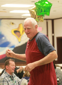 Candace H. Johnson-For Shaw Media  Keith Johnson, of Lake Zurich gets up to claim his prize, corned beef bratwurst, during the Women's Auxiliary Meat Raffle at the Wauconda American Legion Post 911. The raffle was held to raise money for veterans and the community. (3/14/20)