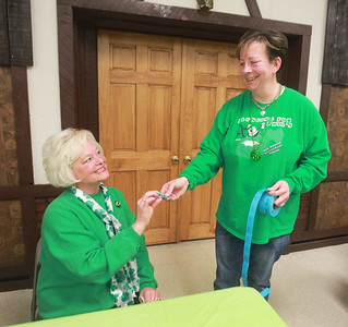 Candace H. Johnson-For Shaw Media  Liz Ross, of Island Lake gets a raffle ticket from Jill Patyk, of Wauconda during the Women's Auxiliary Meat Raffle at the Wauconda American Legion Post 911. The raffle was held to raise money for veterans and the community. (3/14/20)