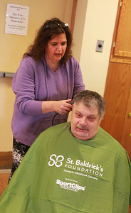 Candace H. Johnson-For Shaw Media  Bob Smith, a retired Fox Lake firefighter, gets his head shaved by Patty Browning, of Island Lake, an independent hair stylist, during the St. Baldrick's Foundation event at the Fox Lake Volunteer Fire Department in Ingleside.  (3/15/20)
