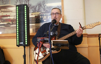 Candace H. Johnson-For Shaw Media  Mark Heller, of Grayslake sings classic rock songs as he performs during the St. Baldrick's Foundation event at the Fox Lake Volunteer Fire Department in Ingleside.  (3/15/20)