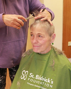 Candace H. Johnson-For Shaw Media  Sue Ryan, of Lake Villa, organizer, gets her hair cut by Patty Browning, of Island Lake, an independent hair stylist, during the St. Baldrick's Foundation event at the Fox Lake Volunteer Fire Department in Ingleside. This is Ryan's sixth year she has shaved her head for the event. Ryan is also a former Chicago police officer who had served for twenty-five years. (3/15/20)