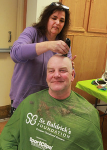 Candace H. Johnson-For Shaw Media  John Calhoun, of McHenry gets his hair and beard shaved off by Patty Browning, of Island Lake, an independent hair stylist, during the St. Baldrick's Foundation event at the Fox Lake Volunteer Fire Department in Ingleside. It took over two years for Calhoun to grow out his hair and beard. (3/15/20)