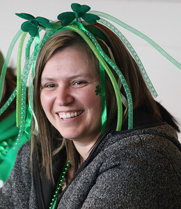 Candace H. Johnson-For Shaw Media Meagan Maier, of Iowa City, Iowa watches leprechaun Peter O'Fool (Pete Kovacevich) do magic tricks with her children during the St. Patrick's Day Weekend Celebration at Timothy O'Toole's Pub in Lake Villa.  (3/14/20)