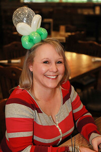 Candace H. Johnson-For Shaw Media Cheri Carter, of Round Lake Beach shows off her balloon headband made by leprechaun, Peter O'Fool, during the St. Patrick's Day Weekend Celebration at Timothy O'Toole's Pub in Lake Villa.  (3/14/20)