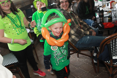 Candace H. Johnson-For Shaw Media Easton Maier, 5, of Iowa City, Iowa shows off his balloon hat made by leprechaun Peter O'Fool (Pete Kovacevich) during the St. Patrick's Day Weekend Celebration at Timothy O'Toole's Pub in Lake Villa.  (3/14/20)