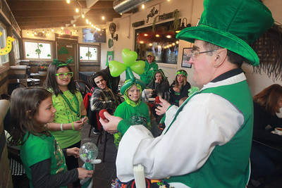Candace H. Johnson-For Shaw Media Leprechaun Peter O'Fool (Pete Kovacevich) does a magic trick for kids during the St. Patrick's Day Weekend Celebration at Timothy O'Toole's Pub in Lake Villa.  (3/14/20)