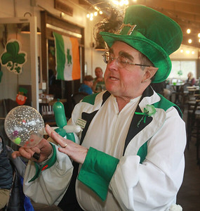 Candace H. Johnson-For Shaw Media Leprechaun Peter O'Fool (Pete Kovacevich) makes a balloon hat for a child during the St. Patrick's Day Weekend Celebration at Timothy O'Toole's Pub in Lake Villa.  (3/14/20)