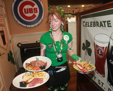Candace H. Johnson-For Shaw Media Kalie Molczan, of Lindenhurst serves plates of corned beef during the St. Patrick's Day Weekend Celebration at Timothy O'Toole's Pub in Lake Villa.  (3/14/20)
