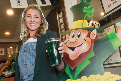 Candace H. Johnson-For Shaw Media Manager Rachel Kahn, of Libertyville shows off a pint of Miller Lite green beer served during the St. Patrick's Day Weekend Celebration at Timothy O'Toole's Pub in Lake Villa.  (3/14/20)