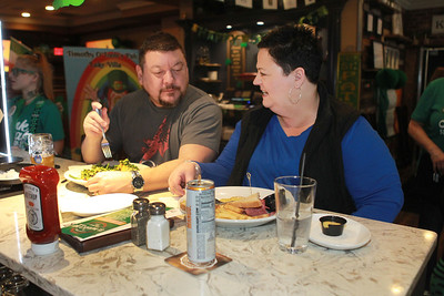 Candace H. Johnson-For Shaw Media Matthew and Barb Howell, of Lindenhurst enjoy their meals during the St. Patrick's Day Weekend Celebration at Timothy O'Toole's Pub in Lake Villa.  (3/14/20)
