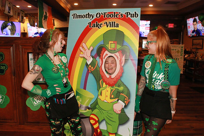 Candace H. Johnson-For Shaw Media Kalie Molczan, of Lindenhurst, Chandra Best, of Lake Villa and Danielle Rognstad, of Antioch, all servers, have fun with a leprechaun picture board during the St. Patrick's Day Weekend Celebration at Timothy O'Toole's Pub in Lake Villa.  (3/14/20)