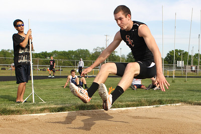 Mike Greene - mgreene@shawmedia.com Crystal Lake Central's Isaih Mosher jumps in the third flight of the long jump finals at the Boy's IHSA Sectional Track and Field Meet Thursday, May 17, 2012 in Rockton. Mosher took third place in the event with a jump of 21ft 3.5in.