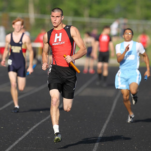 Mike Greene - mgreene@shawmedia.com Huntley's Mike Dollar runs out in front during the second flight of the 4x100-meter relay finals at the Boy's IHSA Sectional Track and Field Meet Thursday, May 17, 2012 in Rockton. Dollar and Huntley took third place in the event with a time of 43.64 seconds.
