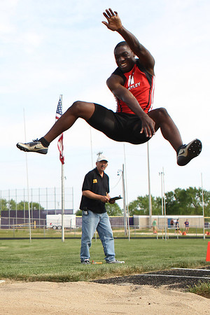 Mike Greene - mgreene@shawmedia.com Huntley's Cj Ayemoba jumps in the third flight of the long jump finals at the Boy's IHSA Sectional Track and Field Meet Thursday, May 17, 2012 in Rockton. Ayemoba scratched on all three atempts.
