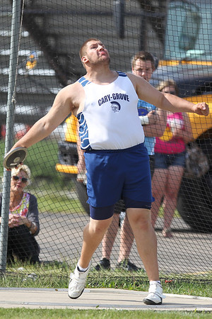 Mike Greene - mgreene@shawmedia.com Cary-Grove's Josh Freeman prepares to release a discus while competing in the discus finals at the Boy's IHSA Sectional Track and Field Meet Thursday, May 17, 2012 in Rockton. Freeman took second place in the discus with a throw of 170ft 5in. Freeman took first place in the shot put with a throw of 60ft 11.75in.