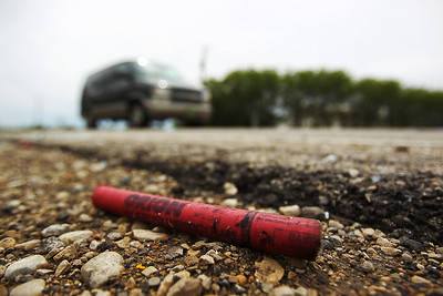 Daniel J. Murphy - dmurphy@shawmedia.com  An emergency flare lays near the intersection of Marengo and Seeman roads Wednesday May 2, 2012 near Huntley. An Algonquin woman was killed and several others were injured Tuesday night in a single-vehicle crash. Megan E. Hartigan, 20, of Algonquin died at Centegra Hospital – Woodstock shortly after the wreck.