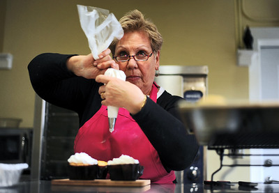 Sarah Nader - snader@shawmedia.com Owner Angela Dudek frosts a batch of vanilla bourbon cupcakes while  working at Sweet Angeline's Bake Shop and Gourmet Cafe in Richmond on Tuesday, May 1, 2012. Dudek opened her bakery last month in a renovated old farm house. The shop features cupcakes, cakes, pastries, breads, soup and sandwich's and will be holding their grand opening on Saturday.