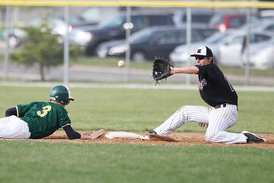 Mike Greene - mgreene@shawmedia.com Prairie Ridge's Brad Schillinger waits for the ball during a pick off attempt as Crystal Lake South's Will Ahsmann slides into second during a game Tuesday, May 1, 2012 in Crystal Lake. Crystal Lake South won the game 2-0.