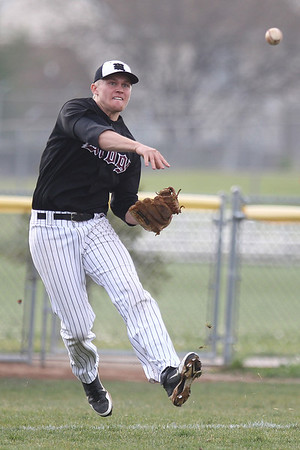 Mike Greene - mgreene@shawmedia.com Prairie Ridge's Corey Peterson becomes air-bound while throwing to first base during a game against Crystal Lake South Tuesday, May 1, 2012 in Crystal Lake. Crystal Lake South won the game 2-0.