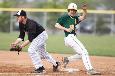 Mike Greene - mgreene@shawmedia.com Crystal Lake South's Jordan Van Dyck makes his way back to first base safely after a failed bunt attempt as Prairie Ridge's Lucas Keller defends the base during a game Tuesday, May 1, 2012 in Crystal Lake. Crystal Lake South won the game 2-0.