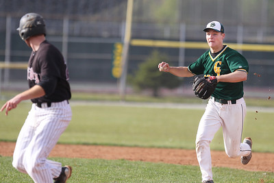 Mike Greene - mgreene@shawmedia.com Crystal Lake South's Jordan Van Dyck (right) chases after Prairie Ridge's Lucas Keller during a rundown in a game Tuesday, May 1, 2012 in Crystal Lake. Crystal Lake South won the game 2-0.