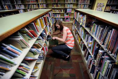 Sarah Nader - snader@shawmedia.com Victoria Steinbach, 20, of Crystal Lake reshelves books while working at the Crystal Lake Public Library on Wednesday, May 2, 2012.The library is planning a $28.6 million expansion that will more than double its current size.
