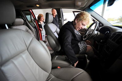 Sarah Nader - snader@shawmedia.com Debbie Degraw (left) and Jim M'Lady look on as Nancy Hiatt, president of Home of the Sparrow checks out the newly donated 2003 Grand Caravan at M'Lady Nissan in Crystal Lake on Wednesday, May 2, 2012. M'Lady donated two vehicles to Home of the Sparrow. Once will be used as means of transportation for women staying at the shelter and the other will be used as a facilities maintenance vehicle.