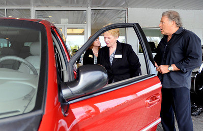 Sarah Nader - snader@shawmedia.com Jim M'Lady, owner of M'Lady Nissan (right) hands he keys of a 2003 Grand Caravan over to Debbie Degraw (left) and Nancy Hiatt, president of Home of the Sparrow at M'Lady Nissan in Crystal Lake on Wednesday, May 2, 2012. M'Lady donated two vehicles to Home of the Sparrow. Once will be used as means of transportation for women staying at the shelter and the other will be used as a facilities maintenance vehicle.