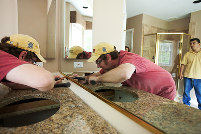 Daniel J. Murphy - dmurphy@shawmedia.com  Tim Naughton from The Granite Guys sets a new mirror Thursday May 3, 2012 at a home on the market in Crystal Lake.