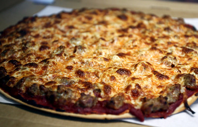 Sarah Nader - snader@shawmedia.com A sausage pizza gets boxed up at Stuc's Pizza in McHenry on Friday, May 4, 2012.