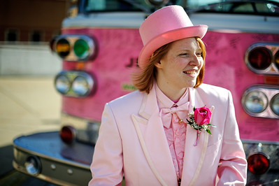 Anneliese Henderson of Crystal Lake stands in front of a pink fire truck Friday May 4, 2012 at Prairie Ridge High School in Crystal Lake. Anneliese went to prom dressed in a pink tuxedo to raise money and awareness for breast cancer. Daniel J. Murphy/The Northwest Herald