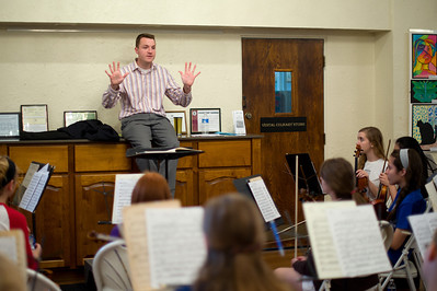 Daniel J. Murphy - dmurphy@shawmedia.com  Gene Power of Champaign conducts a rehearsal of the McHenry County Symphony Orchestra Saturday May 5, 2012 at the Dole Mansion in Crystal Lake. Power will be riding his bike from Champaign, IL to Crystal Lake, IL in a fundraiser for the McHenry County Youth Orchestras on May 15 to 17.