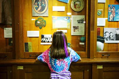Daniel J. Murphy - dmurphy@shawmedia.com  Amanda Tomasi, 10, of Marengo looks at Girl Scout memorabilia on display Sunday May 6, 2012 at the McHenry County Historical Society Museum in Union. On Sunday the society opened a new exhibit that will focus on the history of Girl Scouting in McHenry County. This exhibit was researched and fabricated by Ambassador Girl Scout Sarah French of Huntley in conjunction with her Gold Award Project.