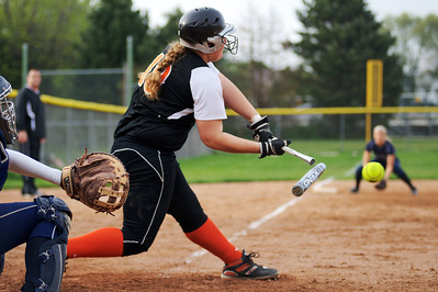 Daniel J. Murphy - dmurphy@shawmedia.com  McHenry's Kelsea Cichocki #19 breaks a bat on a base hit in the seventh inning Monday May 7, 2012 at Cary-Grove High School in Cary. McHenry defeated Cary-Grove 1-0.