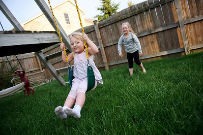 Daniel J. Murphy - dmurphy@shawmedia.com  Aurora Unger, 6, (right) pushes her sister Lorelei, 4, on the swing in the back yard of their home Monday May 7, 2012 in McHenry.