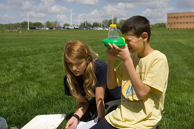 Mike Greene - mgreene@shawmedia.com Hannah Beardsley Middle School students Billy Keaty and Ashley Andrey use a microscope to take a closer look at critters found in a stream Tuesday, May 8, 2012 in Crystal Lake. The event, organized by seventh grade biology teacher Carol Sevrey and Friends of the Fox, gave students a chance to gain hands-on experience and apply skills learned in the classroom. Students at the event measured the physical, chemical, and biological conditions at sites along the stream.