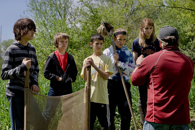 Mike Greene - mgreene@shawmedia.com Students from Hannah Beardsley Middle School listen to Mark Rigby, who assists Friends of the Fox, before testng the water in the stream Tuesday, May 8, 2012 in Crystal Lake. The event, organized by seventh grade biology teacher Carol Sevrey and Friends of the Fox, gave students a chance to gain hands-on experience and apply skills learned in the classroom. Students at the event measured the physical, chemical, and biological conditions at sites along the stream.