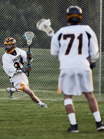 Sarah Nader - snader@shawmedia.com Jacobs' Brenton Cosden brings the ball down field during the first half of Wednesday's game against Huntley in Algonquin on May 9, 2012. Jacobs won, 13-9.