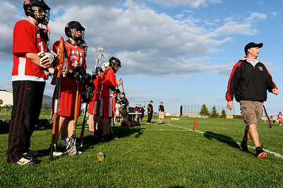 Sarah Nader - snader@shawmedia.com Huntley players watch first half of Wednesday's game against Jacobs in Algonquin on May 9, 2012. Jacobs won, 13-9.