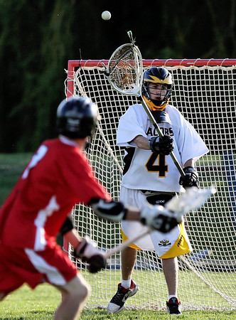 Sarah Nader - snader@shawmedia.com Jacobs goalie Joe Bendewald blocks a shot by Huntley's Nick Steif during the first half of Wednesday's game in Algonquin on May 9, 2012. Jacobs won, 13-9.