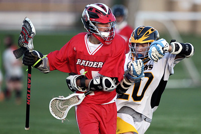 Sarah Nader - snader@shawmedia.com Jacobs' Steven Ta (right) defends Huntley's Tyler Romeiser while he brings the ball down field during the first half of Wednesday's game in Algonquin on May 9, 2012. Jacobs won, 13-9.