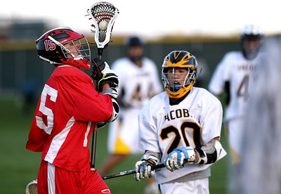 Sarah Nader - snader@shawmedia.com Huntley's Tyler Romeiser (left) protects the ball while being defended by Jacobs Steven Ta  during the first half of Wednesday's game in Algonquin on May 9, 2012. Jacobs won, 13-9.