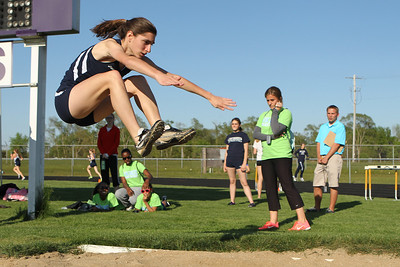 Mike Greene - mgreene@shawmedia.com Cary-Grove's Faith Furio jumps through the air while competing in the long jump at the IHSA Girls Sectional Championship Meet Thursday, May 10, 2012 in Rockton. Cary-Grove won the meet overall and will have entries from all four relays and four individuals going to state.
