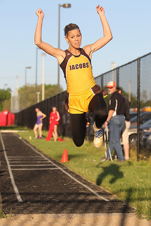 Mike Greene - mgreene@shawmedia.com Jacobs' Allie Virgilio flies through the air while competing in the triple jump at the IHSA Girls Sectional Championship Meet Thursday, May 10, 2012 in Rockton. Virgilio took first place in the event and qualified for state with a jump of 39 1/4. Jacobs qualified three individuals for state.