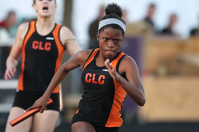 Mike Greene - mgreene@shawmedia.com Crystal Lake Central's Grace Roth bursts after taking a handoff on the second leg of the 4x200 meter relay at the IHSA Girls Sectional Championship Meet Thursday, May 10, 2012 in Rockton. Crystal Lake Central will send two relay teams and four individuals to state with Roth qualifying in the 4x100 and 4x200 relays.